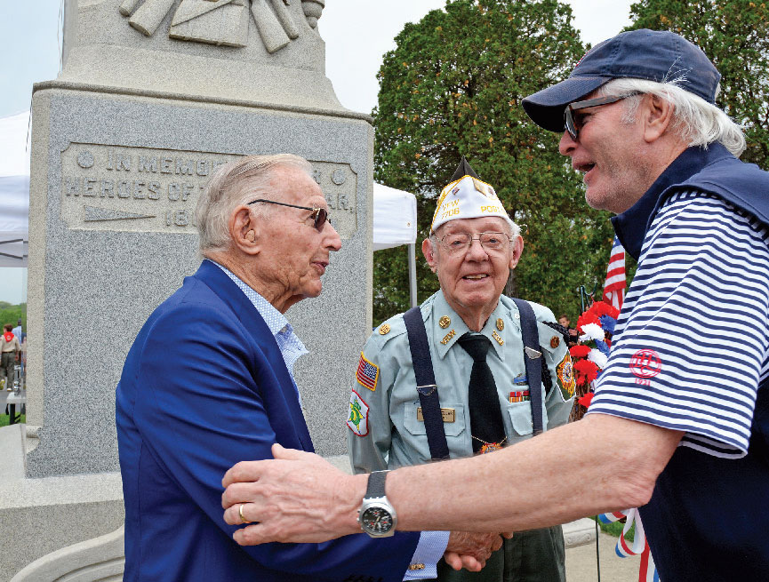 David Nelson (right) greets Richard Duchossois, and the last surviving founder of the Barrington VFW Post #7706, Burnell Wollar